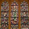 St. Mary Magdalene  window in the upper nave of the church. This window is typical of those contained in the upper nave and the sanctuary. The center panel shows Mary Magdalene in green garments holding a jar.  Green is the symbol of hope.  Mary Magdalene is frequently depicted with a jar in which she carried the oils to anoint Christ's feet.  A cross the symbol of hope and salvation is depicted in the apex.