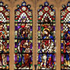 Christ and the Little Children. This window located in the transept is rich in color but a different style than those in the sanctuary and upper nave. It is more representational and without the symbolism of the other windows.